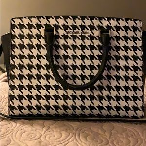 Michael Kors black and white purse.